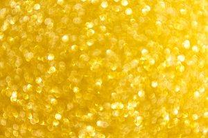 Blurred glitter golden background