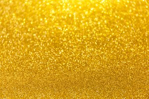 Blurred shot glitter golden backdrop