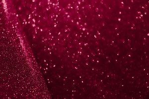 Blurred glitter dark red background