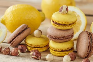 Yellow and brown french macarons wit