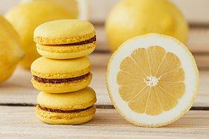 Yellow french macarons with lemons o