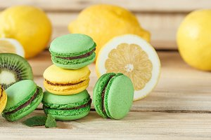 Green and yellow french macarons wit