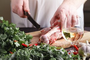 Chef Butcher cutting lamb meat with