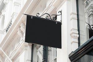 Blank hanging company wall signboard