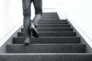 Man walking upstairs indoors