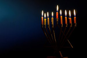 Golden menorah lighted candles