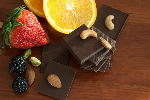 Chocolate, nuts, berries and orange