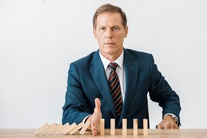 serious businessman with blocks wood