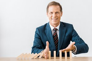 smiling businessman with blocks wood
