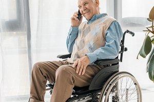 senior smiling man sitting in wheelc