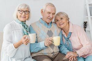happy senior people sitting on sofa