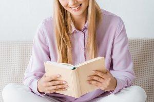 beautiful smiling woman reading book