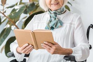 happy senior woman sitting in wheelc