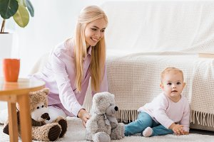 young woman with cute daughter playi
