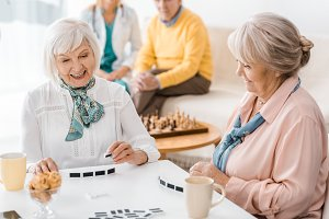 senior women playing domino at white
