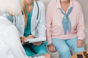 young female nurse sitting on sofa a