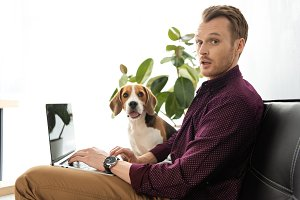surprised male freelancer working on