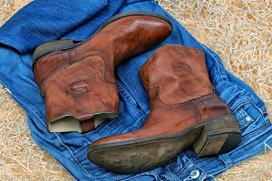 Pair of cowboy boots and blue jeans