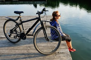 Young athletic woman and bike