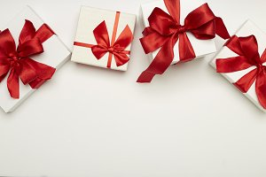 festive gift boxes with red bows