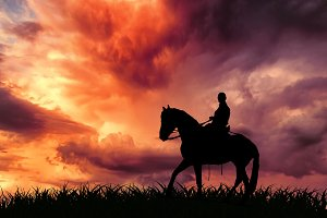 A lone rider riding a horse