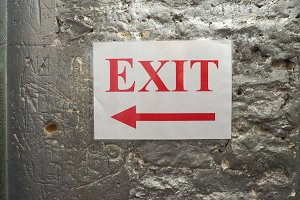 exit sign with direction arrow