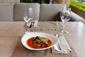 Tomato fish soup on restaurant table