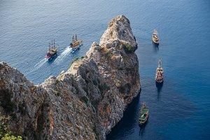 Pirate ships and rocks ni the sea