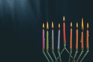 The lit hanukkah candles in menorah
