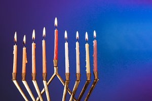 The lit of hanukkah candles in menor