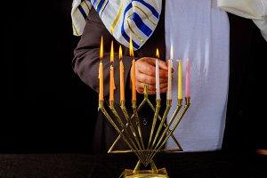 Jewish man blessings Chanukah menora