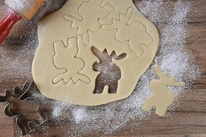 Cookie dough with moose shapes cutte