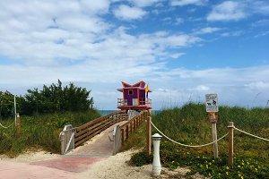 Beach hut and blue skies
