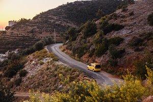 Yellow taxi riding on the mountain
