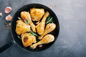 Tasty baked chicken legs with spices