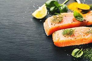 Raw salmon fish on black slate