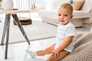 adorable toddler sitting and looking