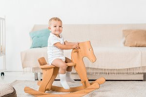 adorable smiling toddler sitting on