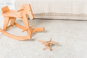 wooden horse and retro airplane toys