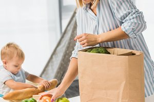 mom holding groceries while talking