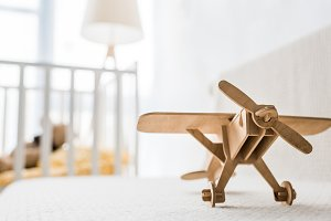 retro wooden toy plane on sofa in nu