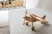 retro wooden toy plane on sofa in nu by  in People