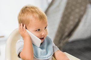 cute toddler talking on smartphone a