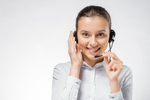 young smiling call center operator w