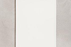 White ceramic cutting board on concr