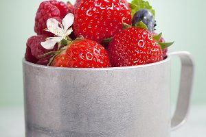 Vintage metal cup with berry