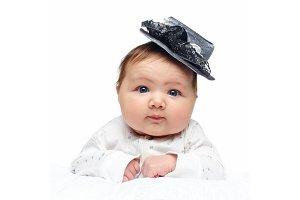 beautiful baby girl in fancy hat on
