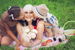 mother with two kids having picnic
