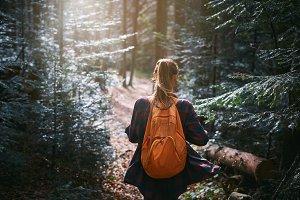 woman hiker walking on the trail in