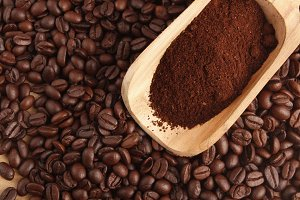 Coffee Beans and Powder on Wooden